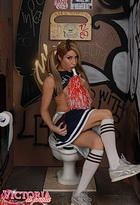 Public toilet cheerleader. Naughty tranny Victoria di Prada exploring the glory hole