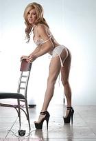 White lingerie. Charming tranny Victoria di Prada posing in lustful lingerie